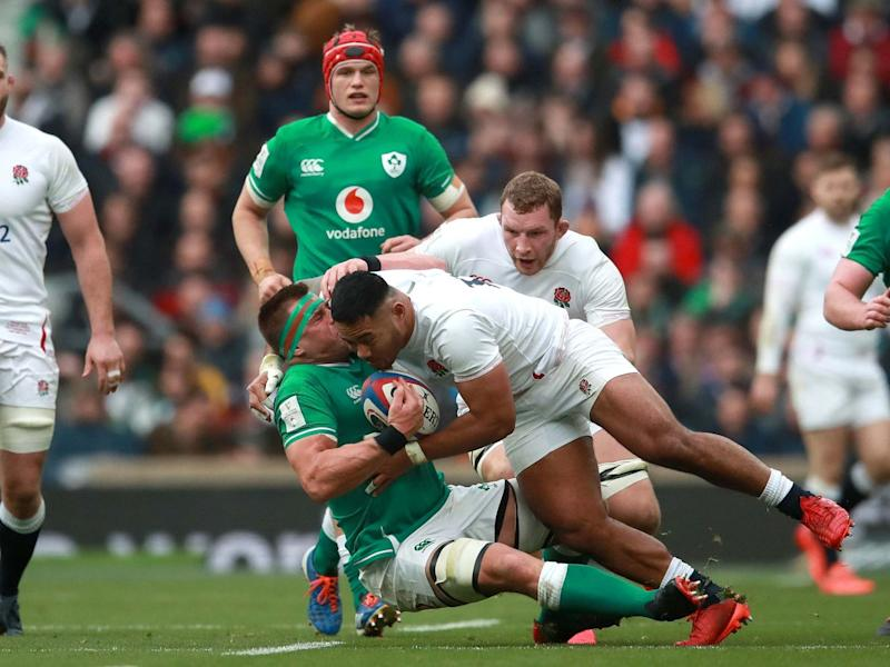 Manu Tuilagi tackles CJ Stander during England's Six Nations victory over Ireland: PA