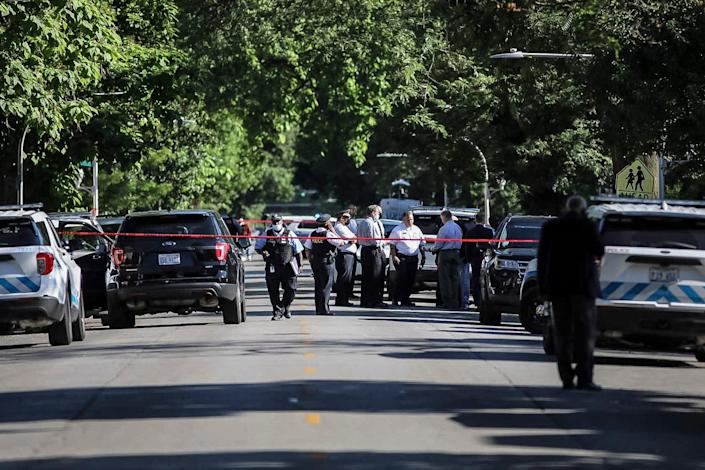 Police investigate the scene of a shooting outside a home in Chicago, Tuesday, June 15, 2021. Police say an argument at a house on Chicago's South Side erupted in fatal gunfire, leaving some dead and others injured.