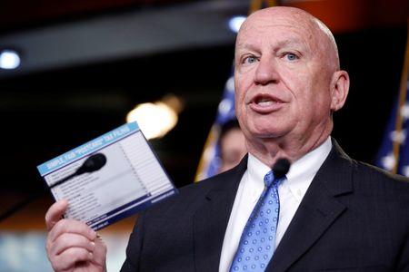 FILE PHOTO: Chairman of the House Ways and Means Committee Kevin Brady (R-TX) holds up a sample tax form as he speaks during a media briefing after the House Republican conference on Capitol Hill in Washington, U.S., April 17, 2018.      REUTERS/Joshua Roberts