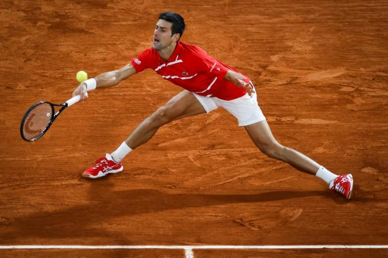 At a stretch: Novak Djokovic in action in last year's final