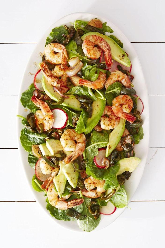 """<p>Loaded with fiery shrimp and poblano peppers, this spicy salad is sure to be a hit.</p><p><em><a href=""""https://www.goodhousekeeping.com/food-recipes/a37556/roasted-shrimp-poblano-salad-recipe/"""" rel=""""nofollow noopener"""" target=""""_blank"""" data-ylk=""""slk:Get the recipe for Roasted Shrimp & Poblano Salad »"""" class=""""link rapid-noclick-resp"""">Get the recipe for Roasted Shrimp & Poblano Salad »</a></em> </p>"""