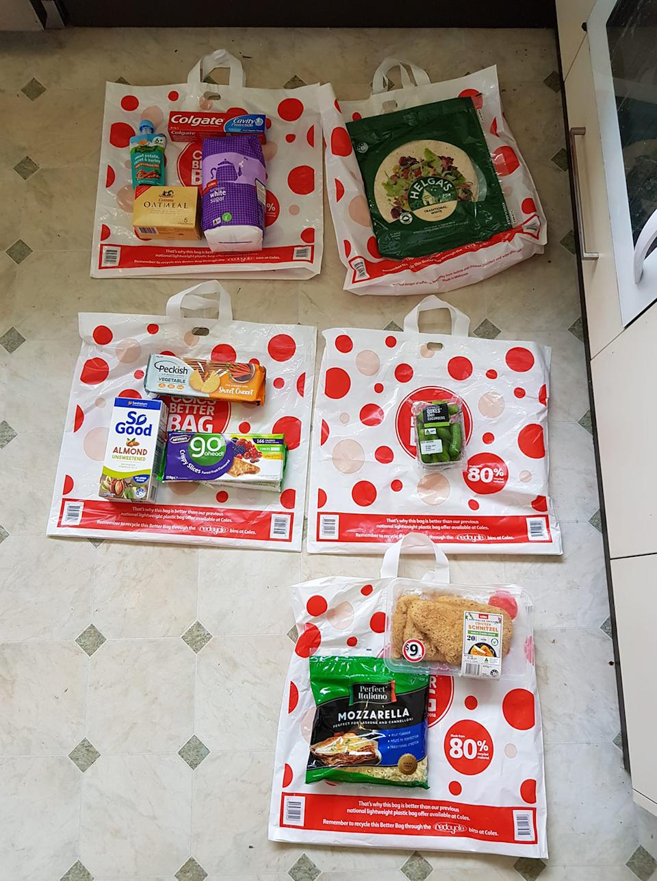 Photo from Facebook of Coles delivery order laid out on the ground.