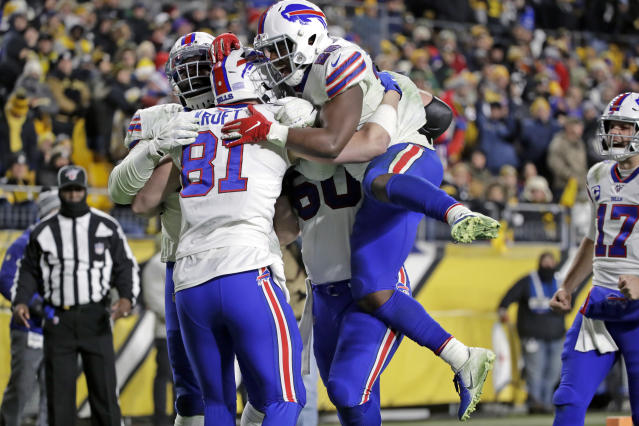 Buffalo Bills tight end Tyler Kroft (81) celebrates with running back Devin Singletary (26) and others after scoring a fourth-quarter touchdowns against the Steelers. (AP Photo/Don Wright)