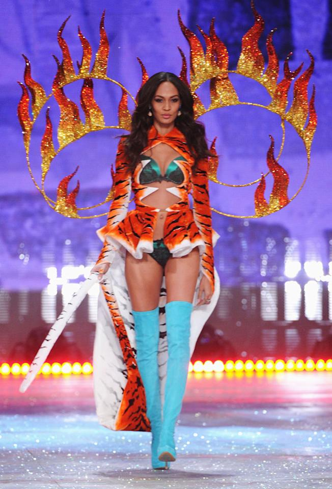 Joan Smalls walks the runway during the 2012 Victoria's Secret Fashion Show at the Lexington Avenue Armory on November 7, 2012 in New York City.