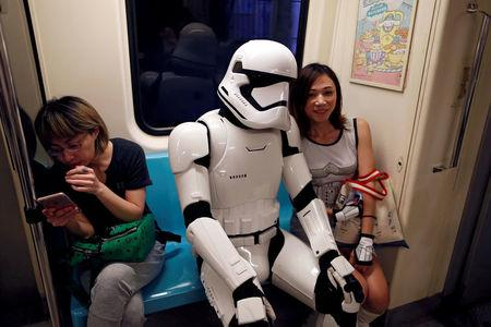"""A fan dressed as a Storm Trooper from """"Star Wars"""" reacts at the Taipei Metro (MRT) during Star Wars Day in Taipei, Taiwan"""