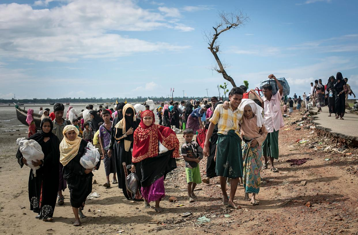 Rohingyas are seen after arriving by boat on Sept. 14, 2017, in Shah Porir Dip, Bangladesh.