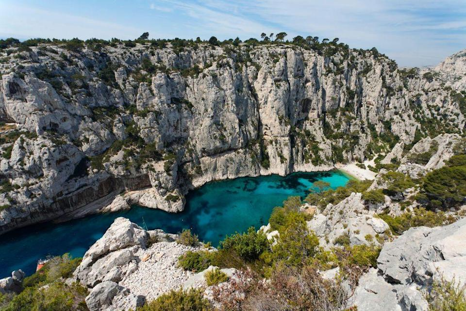 <p>The white sandy beach at Calanque d'En Vau is wedged between two limestone cliff faces. Arrive by kayak if you're up for a bit of adventure and reward yourself with a dip in the iridescent blue water.</p>