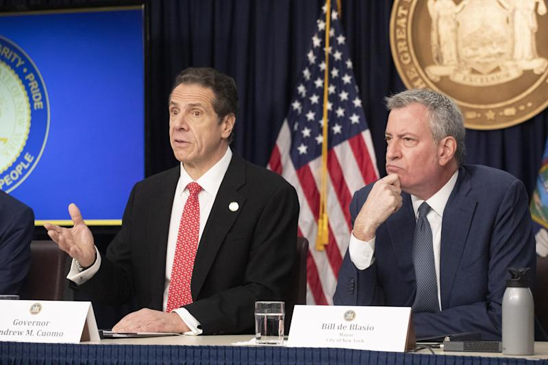 New York Governor Andrew Cuomo, left, and Mayor Bill de Blasio discuss the state and city's preparedness for the spread of the coronavirus on Monday, 2 March, 2020: AP Photo/Mark Lennihan