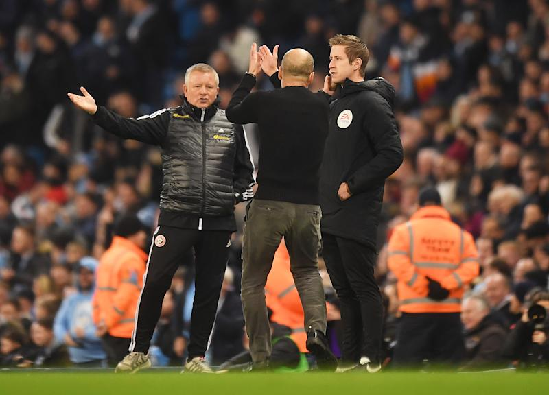 MANCHESTER, ENGLAND - DECEMBER 29: Chris Wilder, Manager of Sheffield United and Pep Guardiola, Manager of Manchester City react during the Premier League match between Manchester City and Sheffield United at Etihad Stadium on December 29, 2019 in Manchester, United Kingdom. (Photo by Michael Regan/Getty Images)