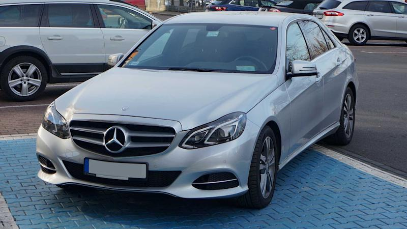 Mercedes improperly parked on a blue badge spot for disabled people