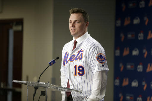 New York Mets' Jay Bruce speaks during a baseball news conference at Citi Field in New York, Wednesday, Jan. 17, 2018. Bruce and the Mets have finalized a $39 million, three-year deal to bring his big bat back to Queens. (AP Photo/Seth Wenig