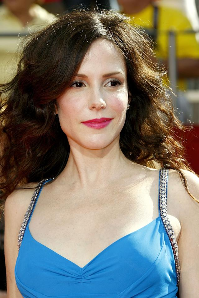 "<p>Her role as Nancy Botwin on <strong>Weeds</strong> earned her a nomination for outstanding lead actress in a comedy series, but there was nothing funny about <a rel=""nofollow"" title=""Latest photos and news for Mary-Louise Parker"" href=""https://www.popsugar.com/Mary-Louise-Parker"">Mary-Louise Parker</a>'s beauty look that night. Her pretty magenta lipstick really popped against her porcelain skin and wavy raven hair. </p>"