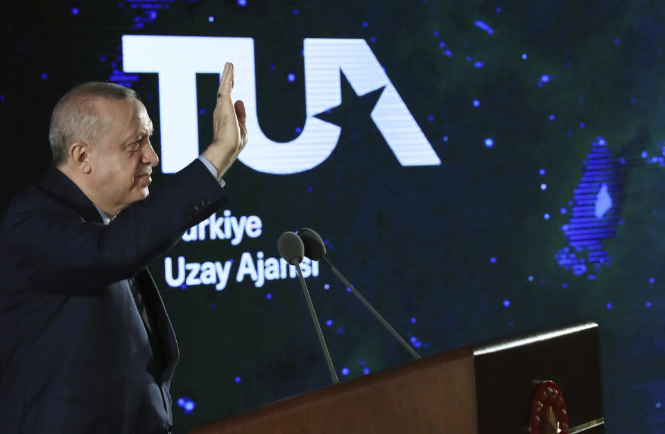 Turkish President Recep Tayyip Erdogan speaks in Ankara, Turkey, late Tuesday, Feb. 9, 2021. Erdogan unveiled Tuesday an ambitious 10-year space program for his country, including missions to the moon, sending Turkish astronauts into space and developing internationally-competent satellite systems. (Turkish Presidency via AP, Pool)
