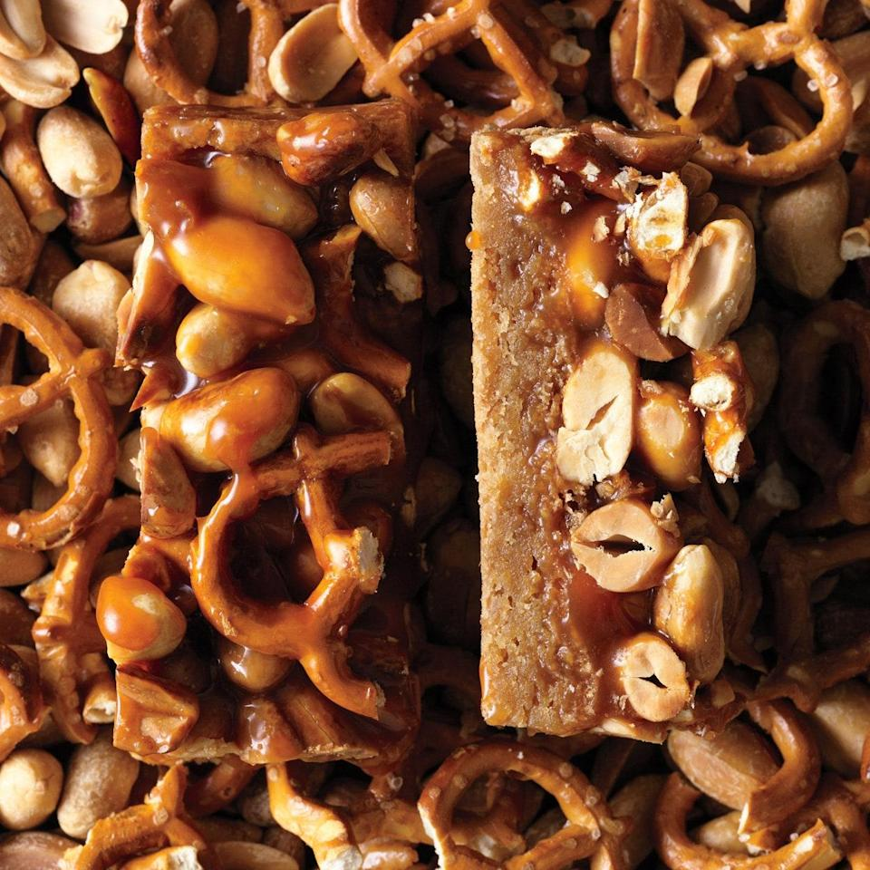"""Coarsely crushed pretzels add crunch and just the right amount of salt to these sweet bars. <a href=""""https://www.epicurious.com/recipes/food/views/butterscotch-blondie-bars-with-peanut-pretzel-caramel-368950?mbid=synd_yahoo_rss"""" rel=""""nofollow noopener"""" target=""""_blank"""" data-ylk=""""slk:See recipe."""" class=""""link rapid-noclick-resp"""">See recipe.</a>"""