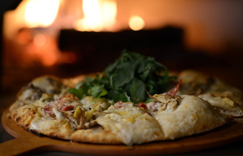 WASHINGTON, D.C, OCTOBER 4, 2013: The new Hawk & Dove offers white pizza with wild mushrooms. backed in a pizza wood oven. (Photo by Astrid Riecken for The Washington Post via Getty Images)