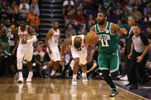 PHOENIX, AZ - NOVEMBER 08: Kyrie Irving #11 of the Boston Celtics controls the ball off a turnover against the Phoenix Suns during overtime of the NBA game at Talking Stick Resort Arena on November 8, 2018 in Phoenix, Arizona. The Celtics defeated the Suns 116-109 in overtime. (Photo by Christian Petersen/Getty Images)