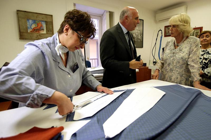 Maurizio Marinella shows Camilla Duchess of Cornwall the tie laboratory at his company in downtown Naples (REUTERS)