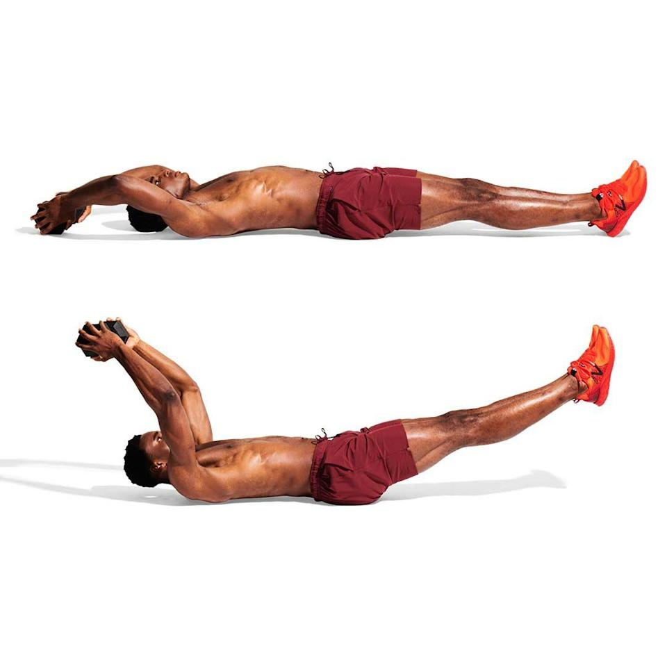 <p>Hold a weight and lie with your legs straight, arms overhead (A). Squeeze your core. Lift your arms, shoulders and legs off the floor. Hold, pressing your lower back down (B). Rock back and forth.<br></p>