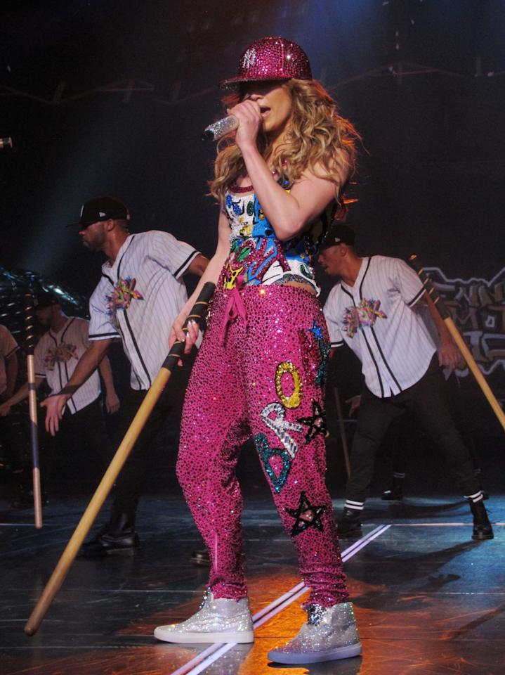 "<p>Lopez stayed true to her roots in a crystal-covered hot pink New York Yankees cap, jogger pants, and a bodysuit that were emblazoned with ""Bronx."" <i>(Photo: Splash News)</i></p>"
