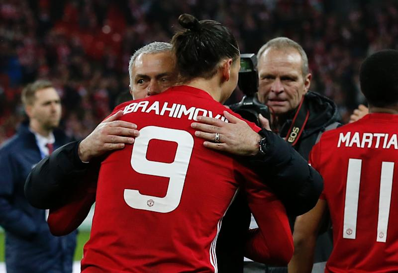 Manchester United's Swedish striker Zlatan Ibrahimovic embraces Manchester United's Portuguese manager Jose Mourinho as players celebrate on the pitch after their victory in the English League Cup final football match between Manchester United and Southampton at Wembley stadium in north London on February 26, 2017. Zlatan Ibrahimovic sealed the first major silverware of Jose Mourinho's Manchester United reign and broke Southampton's hearts as the Swedish star's late goal clinched a dramatic 3-2 victory in Sunday's League Cup final. / AFP / Ian KINGTON / RESTRICTED TO EDITORIAL USE. No use with unauthorized audio, video, data, fixture lists, club/league logos or 'live' services. Online in-match use limited to 75 images, no video emulation. No use in betting, games or single club/league/player publications. / (Photo credit should read IAN KINGTON/AFP via Getty Images)