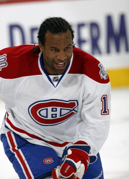 Montreal Canadiens right winger Georges Laraque warms up before facing the Colorado Avalanche in the first period of an NHL hockey game in Denver on Friday, Feb. 13, 2009. (AP Photo/David Zalubowski)