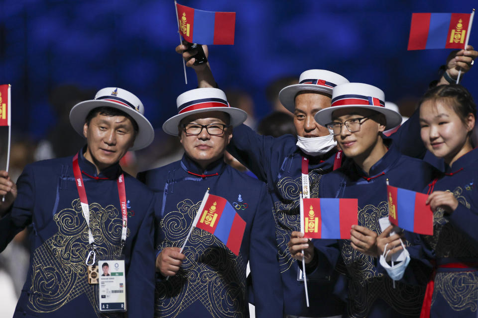 TOKYO, JAPAN - JULY 23: Athletes from Team Mongolia look on during the Opening Ceremony of the Tokyo 2020 Olympic Games at Olympic Stadium on July 23, 2021 in Tokyo, Japan. (Photo by Jamie Squire/Getty Images)