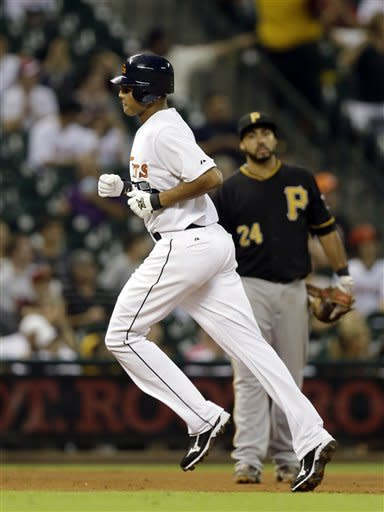 Houston Astros' Justin Maxwell, left, runs past Pittsburgh Pirates third baseman Pedro Alvarez (24) after hitting a home run during the sixth inning of a baseball game on Friday, Sept. 21, 2012, in Houston. (AP Photo/David J. Phillip)