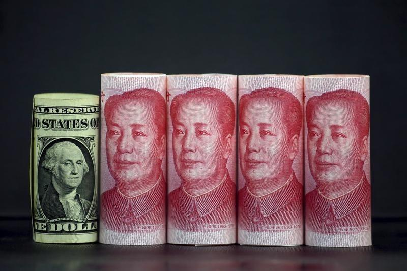 Chinese 100 yuan banknotes and a U.S. one dollar banknote are seen in this picture illustration in Beijing, China