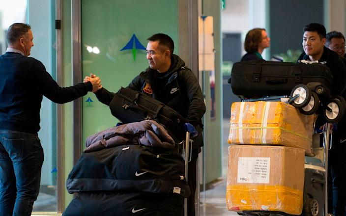 Members of Wuhan Zall FC Chinese football team arrive at the Malaga's Costa del Sol Airport on January 29, 2020 - Jorge Guerrero/AFP