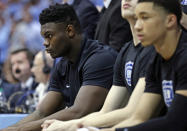 Injured Duke player Zion Williamson, left, sits on the bench during the first half of an NCAA college basketball game against North Carolina in Chapel Hill, N.C., Saturday, March 9, 2019. (AP Photo/Gerry Broome)