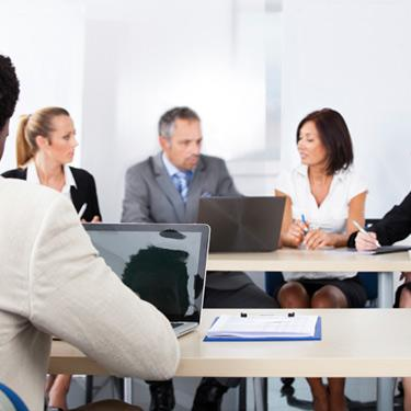 Group-of-businesspeople-discussing-together_web
