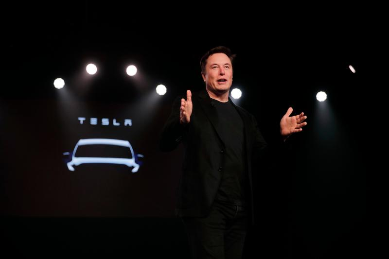 In this March 14, 2019, file photo Tesla CEO Elon Musk speaks before unveiling the Model Y at Tesla's design studio in Hawthorne, Calif.