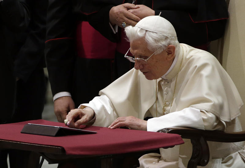 "Pope Benedict XVI pushes a button on a tablet at the Vatican, Wednesday, Dec. 12, 2012. In perhaps the most drawn out Twitter launch ever, Pope Benedict XVI pushed the button on a tablet brought to him at the end of his general audience Wednesday. It read: ""Dear friends, I am pleased to get in touch with you through Twitter. Thank you for your generous response. I bless all of you from my heart.""Later in the day he was to respond to a few messages sent to him from around the world.As the countdown to his first tweet from his Twitter handle (at)Pontifex neared, the pope had garnered nearly 1 million followers in the eight languages of his account. (AP Photo/Gregorio Borgia)"