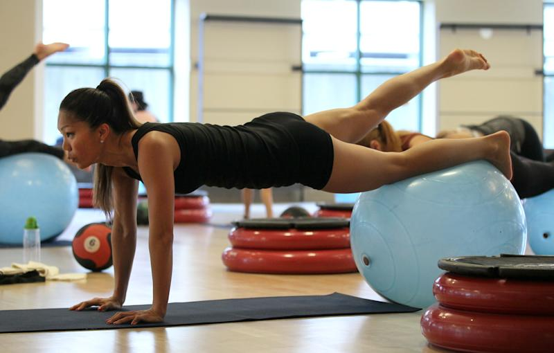 BOSTON - MARCH 28: Shirlene Chi does core work on a balance ball during exercise class at Equinox health club in the Back Bay neighborhood. (Photo by Joanne Rathe/The Boston Globe via Getty Images)