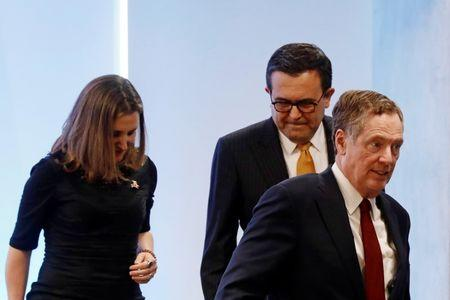 U.S. Trade Representative Robert Lighthizer leaves the room next to Canadian Foreign Minister Chrystia Freeland and Mexican Economy Minister Ildefonso Guajardo after a joint news conference on the closing of the seventh round of NAFTA talks in Mexico City, Mexico March 5, 2018. REUTERS/Edgard Garrido