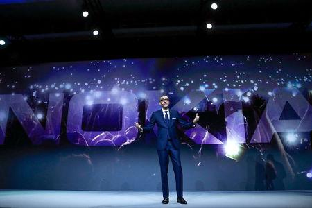 FILE PHOTO: Rajeev Suri, Nokia's President and Chief Executive Officer, speaks during the Mobile World Congress in Barcelona