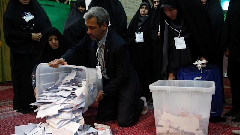 Iran conservatives claim victory after record low turnout
