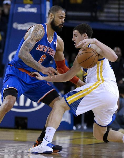 Golden State Warriors' Klay Thompson, right, drives against the New York Knicks' Tyson Chandler (6) during the first half of an NBA basketball game Monday, March 11, 2013, in Oakland, Calif. (AP Photo/Ben Margot)