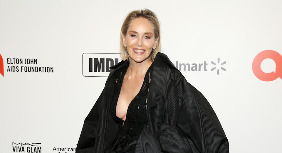 Sharon Stone, 63, wishes fans a 'happy summer' as she wows in yellow bikini
