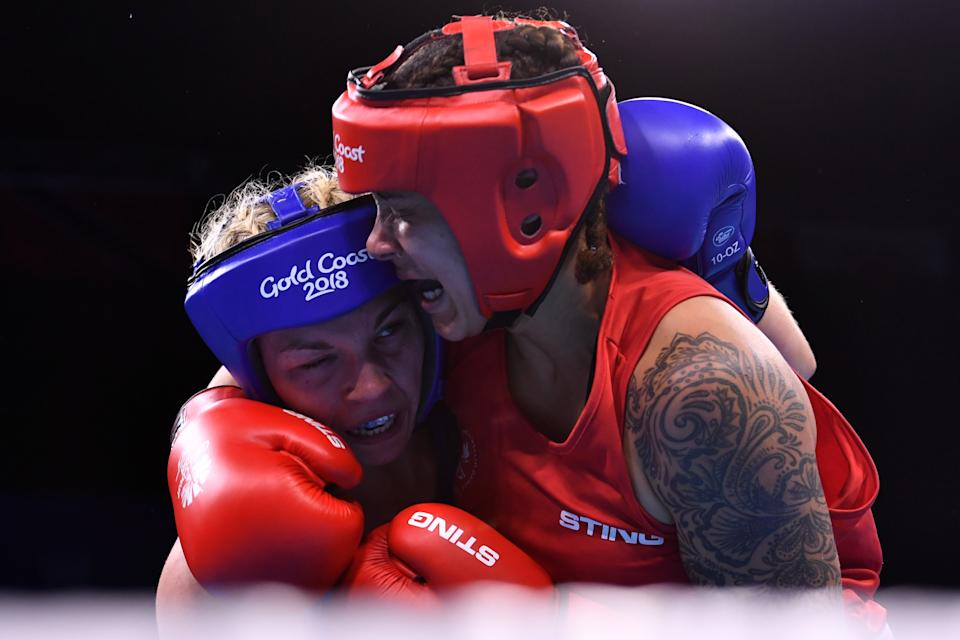 Canada's Tammara Thibeault (R) fights with Wales' Lauren Price during their women's 75kg semi-final boxing match during the 2018 Gold Coast Commonwealth Games at the Oxenford Studios venue on the Gold Coast on April 13, 2018. / AFP PHOTO / Anthony WALLACE        (Photo credit should read ANTHONY WALLACE/AFP via Getty Images)
