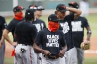 Baltimore Orioles players warm up in Black Lives Matter T-shirts before an opening day baseball game against the Boston Red Sox at Fenway Park, Friday, July 24, 2020, in Boston. (AP Photo/Michael Dwyer)