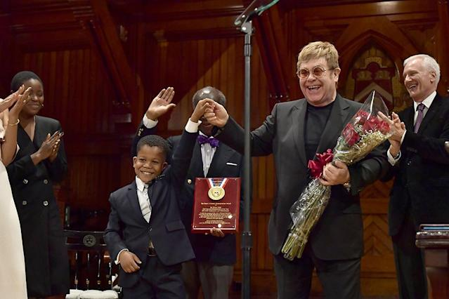 "<p>Sir Elton John got flowers from Chase Sullivan, the son of a Harvard professor, after receiving the 2017 Humanitarian of the Year Award at Harvard University on Monday. In his acceptance speech, the songwriter admitted he had come a long way from the drug and alcohol addict he once was and urged others not to make the same mistakes. ""I'm really a kind person, but the drugs made me a monster,"" he shared. ""Do not waste your life. I wasted my life, but I'm making up for lost time now."" (Photo: Paul Marotta/Getty Images) </p>"