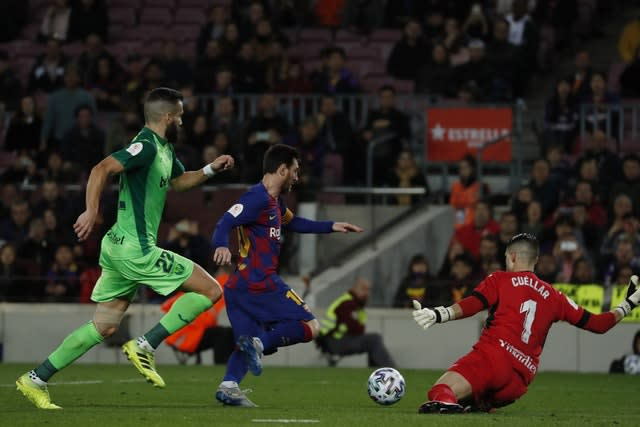 Lionel Messi scored his 18th and 19th goals of the season for Barcelona in the 5-0 win against Leganes (Joan Monfort/AP)