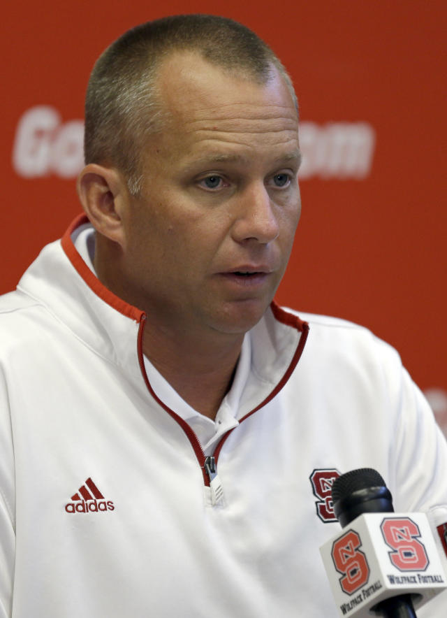 North Carolina State coach Dave Doeren speaks with reporters during an NCAA football media day in Raleigh, N.C., Sunday, Aug. 10, 2014. (AP Photo/Gerry Broome)