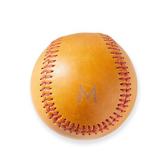 """For the dad who coached your Little League team, bring the memories back with a monogrammed leather baseball. $49, Mark & Graham. <a href=""""https://www.markandgraham.com/products/monogrammed-leather-baseball/"""" rel=""""nofollow noopener"""" target=""""_blank"""" data-ylk=""""slk:Get it now!"""" class=""""link rapid-noclick-resp"""">Get it now!</a>"""
