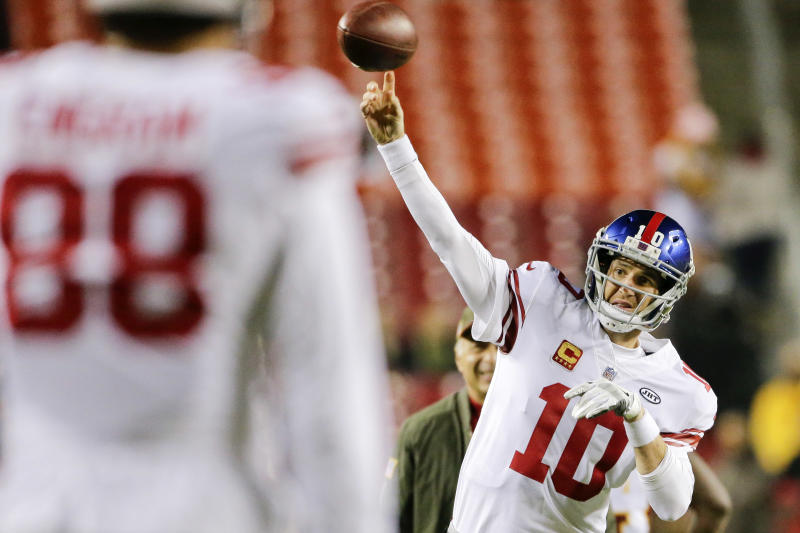 New York Giants quarterback Eli Manning has been benched by coach Ben McAdoo. (AP)