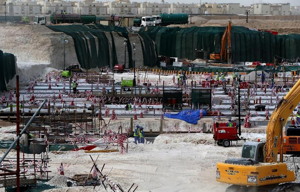 Foreign laborers work at the construction site of the al-Wakrah football stadium in 2015 (AFP Photo/MARWAN NAAMANI)