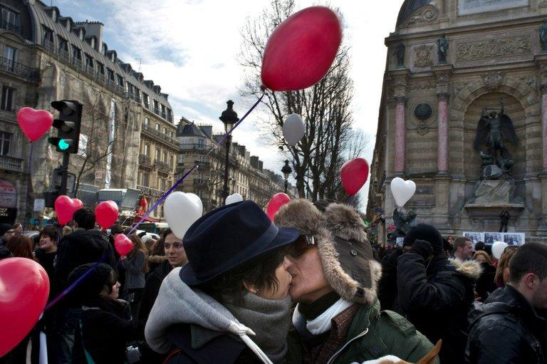 File picture shows couples kissing on Valentine's Day in Paris