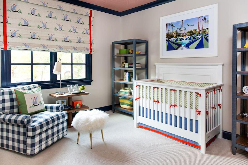 """<p>Soft, cozy materials? Check. Timeless furniture? Check. Bows? Check. This nursery designed by <a href=""""http://maalleninteriors.com/"""" rel=""""nofollow noopener"""" target=""""_blank"""" data-ylk=""""slk:MA Allen"""" class=""""link rapid-noclick-resp"""">MA Allen</a> strikes the perfect balance between child-friendly and bold. The bright red and deep blue accents spice up the cream foundation. We're loving unexpected the pops of green, too. Instead of super-sweet, baby-specific artwork, opt for playful but versatile photography, like this California snapshot. </p>"""
