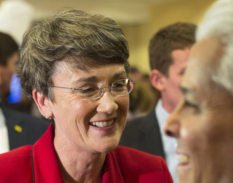 FILE - In this Nov. 6,2012 file photo, then-Republican nominee Heather Wilson visits with supporters at the Republican election party in Albuquerque, N.M. Wilson collected nearly half a million dollars in questionable payments from four federally funded nuclear labs after she left office, the Energy Department's inspector general says in a new report. (AP Photo/Jake Schoellkopf, File)